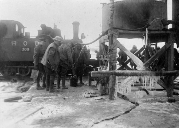 Light railway engine taking in water at a point in Trones Wood, December 1916 © IWM (Q 1692)